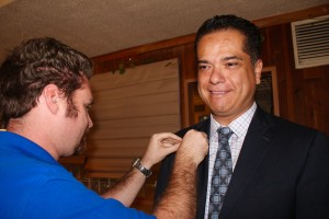 New Rotarian, Scott De La Torre, being pinned by his sponsor